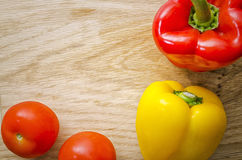 Peppers and Tomatoes. Flat lay shot of red and yellow peppers and two tomatoes Stock Photo