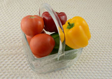 Peppers and tomatoes in glass basket Royalty Free Stock Images