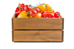 Peppers and tomatoes in wooden box Royalty Free Stock Photos