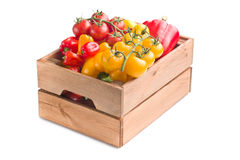Peppers and tomatoes in wooden box Royalty Free Stock Images