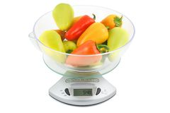 Peppers weighed on kitchen scales Royalty Free Stock Images
