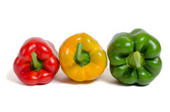 Peppers on a white background. Miscellaneous colored fresh vegetables peppers on a white background Stock Photography