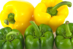 Peppers on white plate isolated close up Stock Image