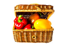 Peppers in wicker basket. Multicolored peppers in wicker basket isolated on the white background Stock Photos