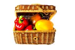 Peppers in wicker basket Stock Photos