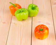 Peppers on wood table Royalty Free Stock Image