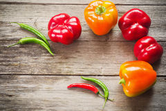 Peppers on wooden background royalty free stock photos