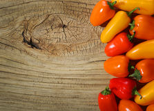 Peppers on wooden background Royalty Free Stock Photography
