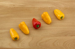 Peppers on a Wooden Cutting Board Stock Images