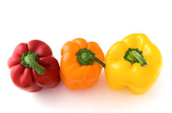 Peppers yellow, orange and red. Cheerful colours three peppers yellow, orange and red stock photography