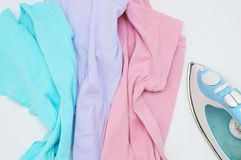 Peppery multi-colored clothes and iron royalty free stock images