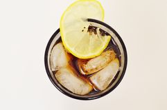Peppsi. Drink lemon blach glass cup Stock Photo