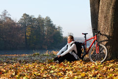 Peppy woman cyclist enjoy the recreation in nature Stock Photo