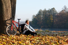 Peppy woman cyclist recreation autumn in nature Royalty Free Stock Image