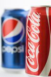 Pepsi and Coca-Cola cans. Cans of Pepsi and Coca-Cola. They are among the most popular carbonated drinks in the world Royalty Free Stock Photos