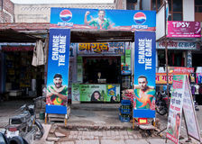 Pepsi Cola advertisement at small food store. Royalty Free Stock Photos