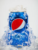 Pepsi embedded in ice. BARCELONA, SPAIN - JUNE 3: Food and drink stylist Hans Geel creates an ice cold can of Pepsi Cola embedded in ice stock images