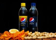 Pepsi and pepsi twist. ZAGREB , CROATIA - JANUARY 24 ,2014 :  plastic bottle of soft drink pepsi cola and pepsi twist by pepsico company on black background Stock Photography