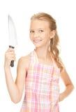 Pequeña ama de casa con el cuchillo Imágenes de archivo libres de regalías