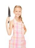 Pequeña ama de casa con el cuchillo Fotografía de archivo