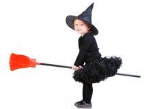Pequeña bruja en el palo de escoba Imagen de archivo