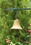 Pequeña campana de oro Fotografía de archivo