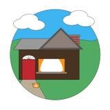 Pequeña casa en un césped verde Foto de archivo libre de regalías