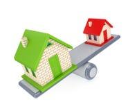 Pequeña casa y casa grande en escalas simples. Foto de archivo libre de regalías