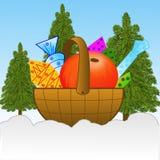 Pequeña cesta con los regalos encendido a nevar área de la pista de aterrizaje Imágenes de archivo libres de regalías