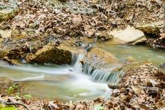 Pequeña corriente del agua Imagenes de archivo