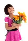 Pequeña flor asiática de la muchacha Fotos de archivo libres de regalías