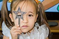 Pequeña hada con una varita mágica Foto de archivo libre de regalías