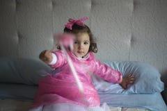 Pequeña hada rosada con la vara mágica Fotos de archivo libres de regalías