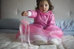 Pequeña hada rosada con la vara mágica Foto de archivo
