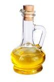 Pequeña jarra con aceite de oliva en el blanco Fotos de archivo libres de regalías