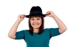 Pequeña muchacha adorable con el sombrero negro Foto de archivo libre de regalías