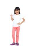Pequeña muchacha asiática con el dedo índice para arriba Foto de archivo libre de regalías