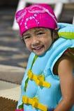 Pequeña muchacha asiática en traje de baño. Imagen de archivo libre de regalías