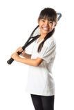 Pequeña muchacha asiática que sostiene la estafa de tenis Imagen de archivo libre de regalías