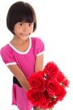 Pequeña muchacha asiática que sostiene una rosa Fotos de archivo libres de regalías