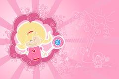 Pequeña muchacha de los niños con el primer del caramelo Imagen de archivo libre de regalías