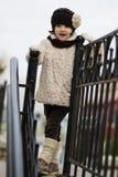 Pequeña muchacha de moda en ropa caliente Foto de archivo libre de regalías