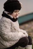 Pequeña muchacha de moda en ropa caliente Fotos de archivo libres de regalías