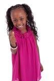 Pequeña muchacha del afroamericano que hace los pulgares para arriba Imagen de archivo
