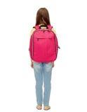 Pequeña muchacha del estudiante con el bolso de escuela de la parte posterior Fotos de archivo libres de regalías