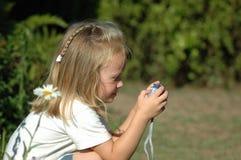 Pequeña muchacha del fotógrafo Fotografía de archivo