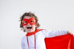 Pequeña muchacha del niño del super héroe imagenes de archivo