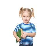 Pequeña muchacha divertida con los libros Imagenes de archivo