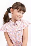 Pequeña muchacha divertida en fondo ligero Fotos de archivo libres de regalías