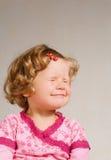 Pequeña muchacha en una alineada del silbido de bala Foto de archivo libre de regalías